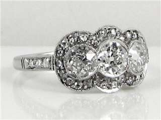 EDWARDIAN 1.30CT OLD MINE CUT DIAMOND THREE STONE RING PLATINUM
