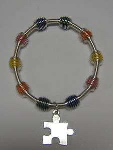NEW AUTISM AWARENESS SPRING BRACELET PUZZLE PIECE CHARM