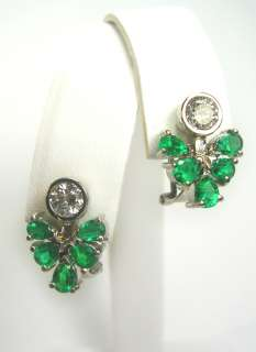 natural vibrant green emeralds and scintillating diamond s
