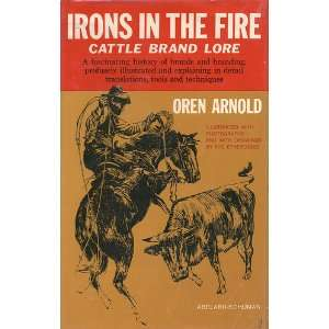 Irons in the fire;: Cattle brand lore: Oren Arnold:  Books