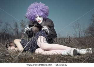 stock photo  Sleeping girl outdoors and crazy maniac clown touching